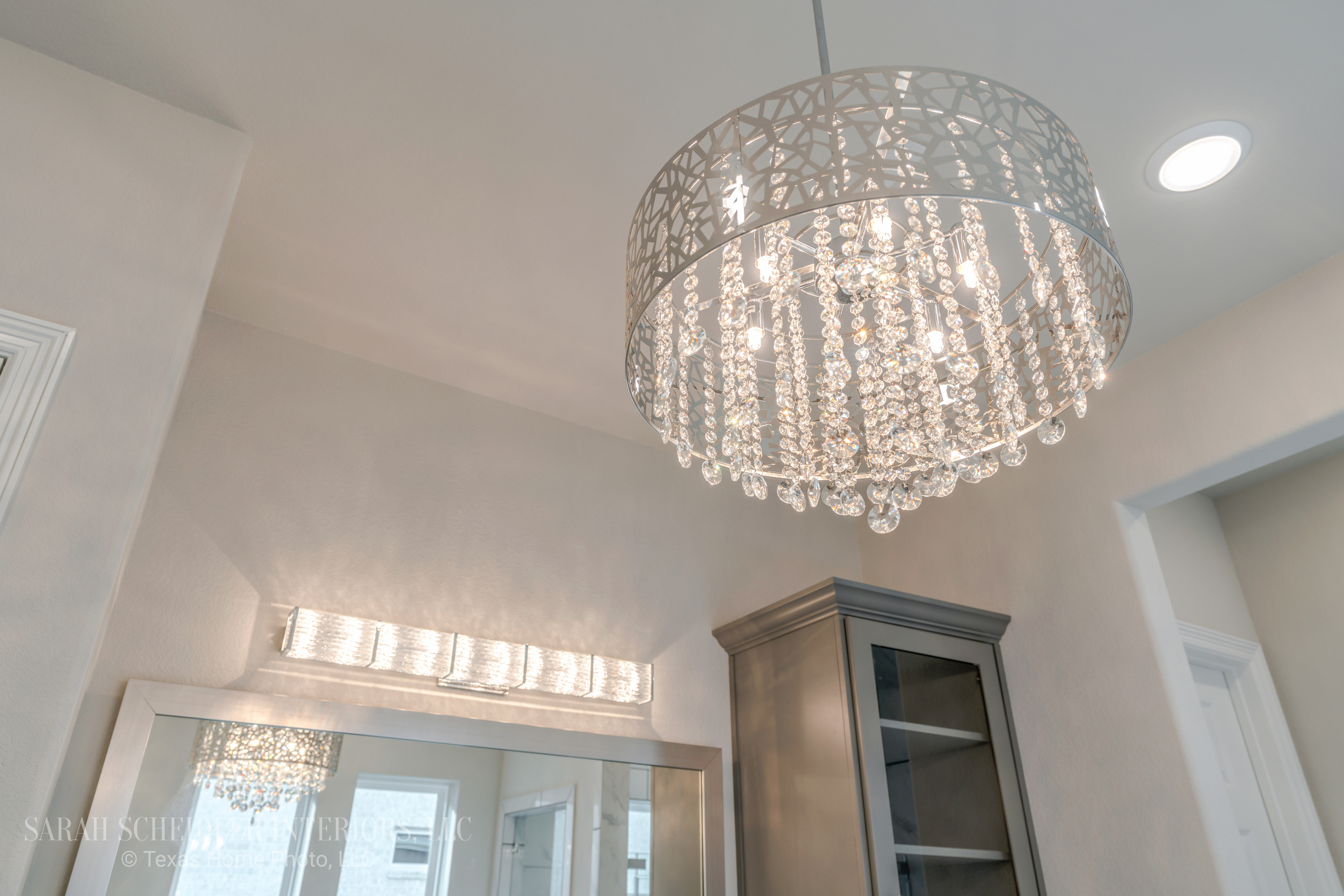 Crystal and Chrome Chandelier in Grey and White Master Bathroom