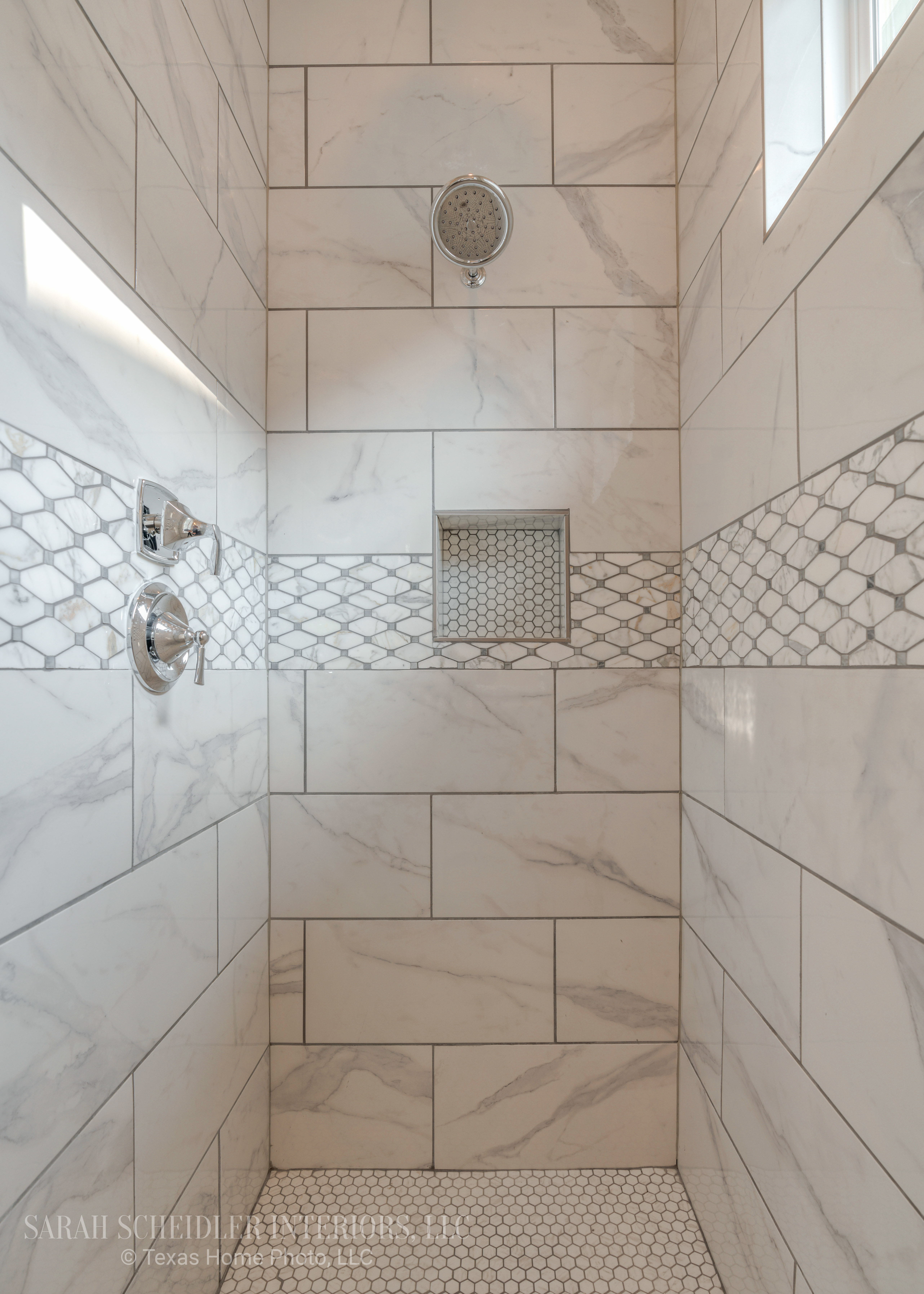 White and Grey Master Bathroom Walk-In Shower with Stunning Accent Tile and Chrome Finishes