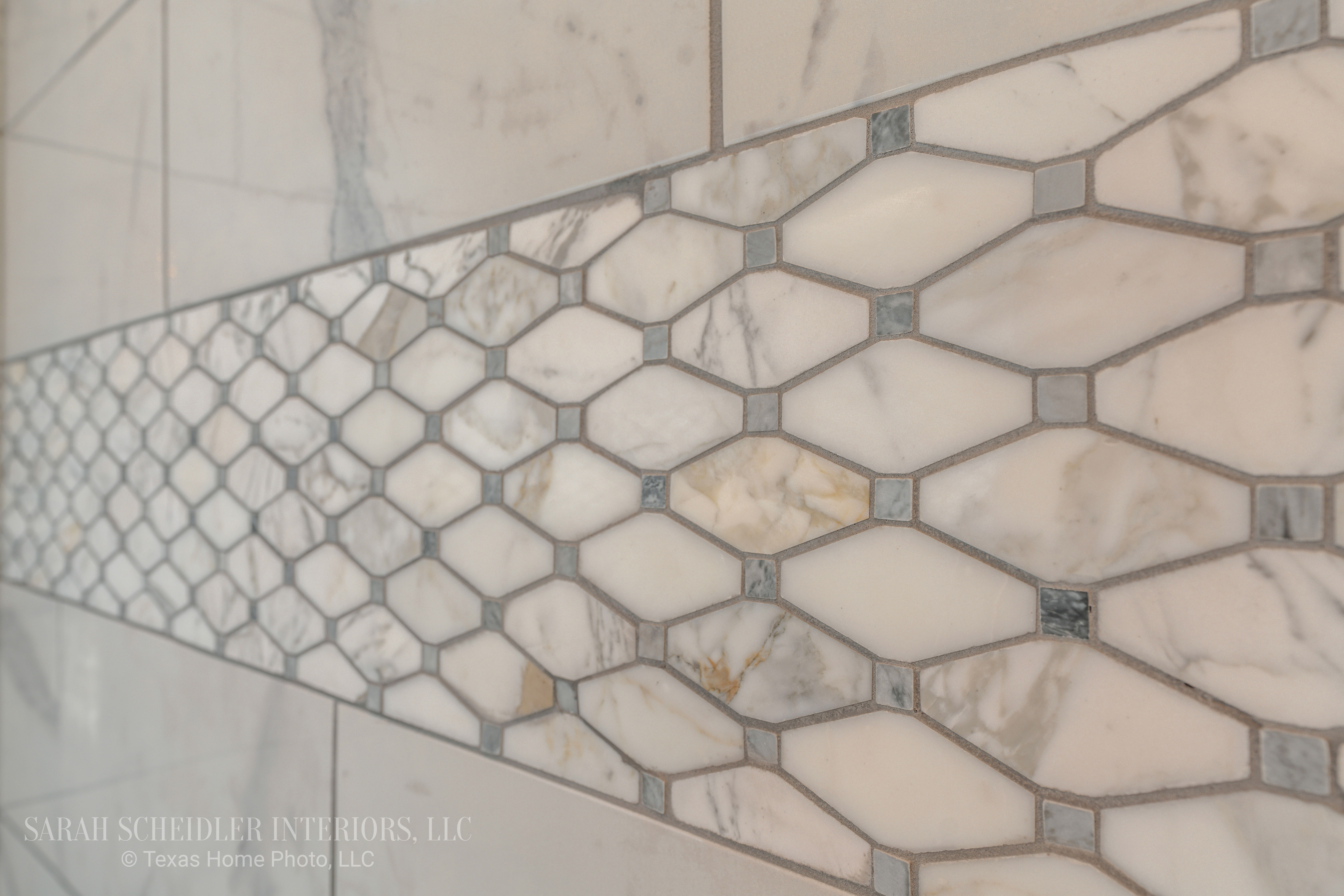 White and Grey Marble Accent Tile in Primary Bathroom Shower