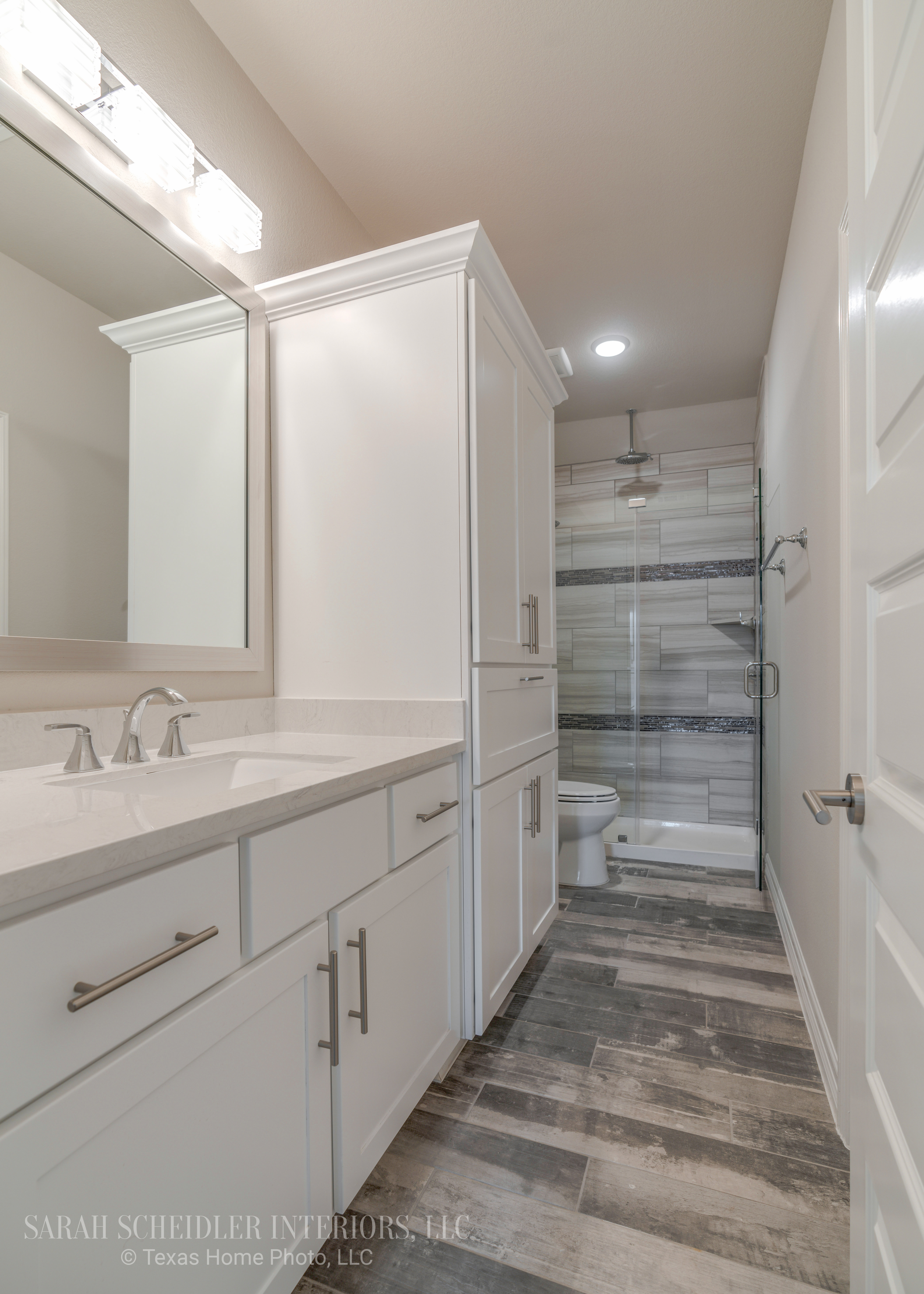 White Secondary Bathroom Design with Silestone Quartz Countertops, Chrome Accents, and Rustic Wood Tile Flooring