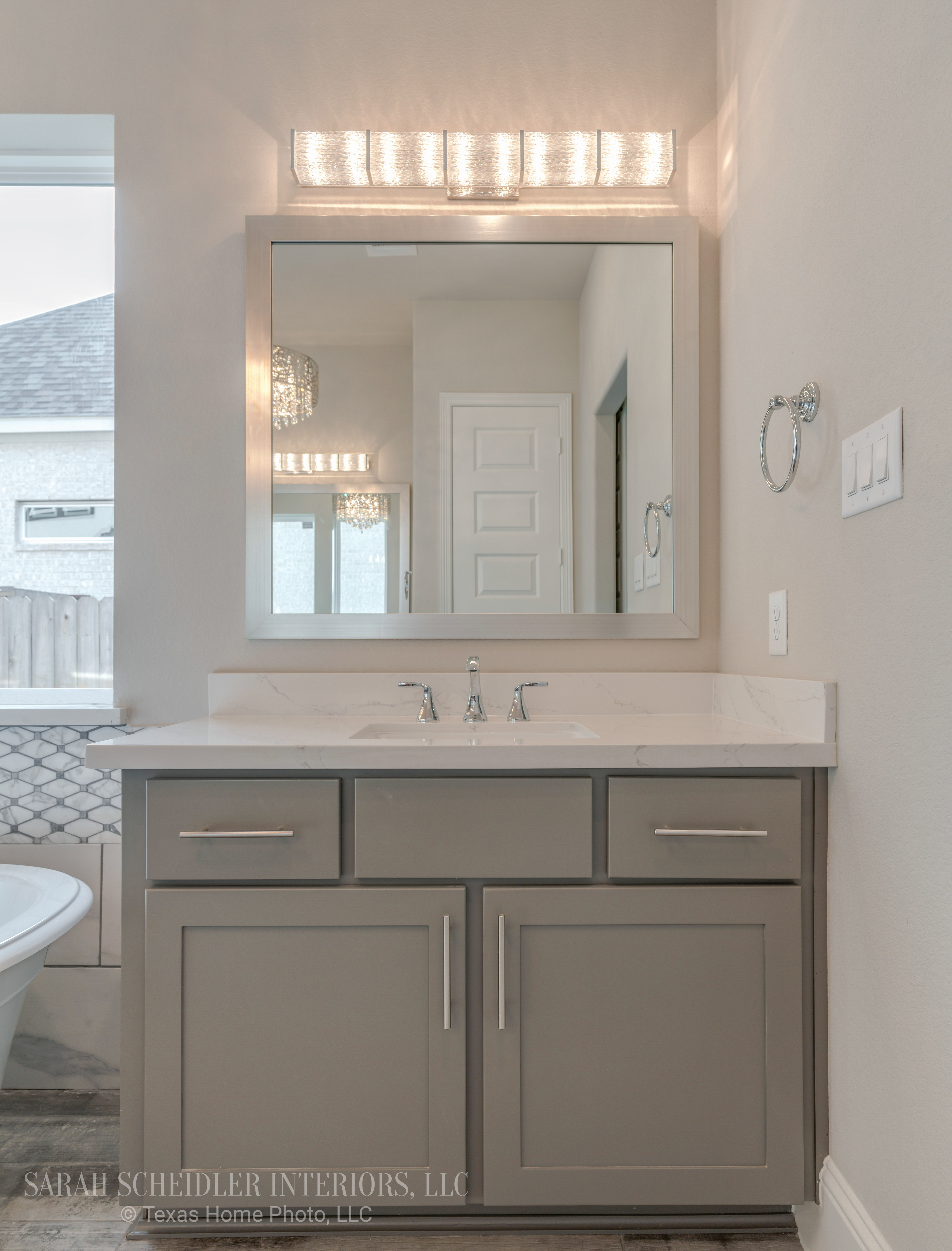 White and Grey Primary Bathroom Vanity (His) with Silestone Quartz Countertops, Chrome Finishes, and Crystal Lighting