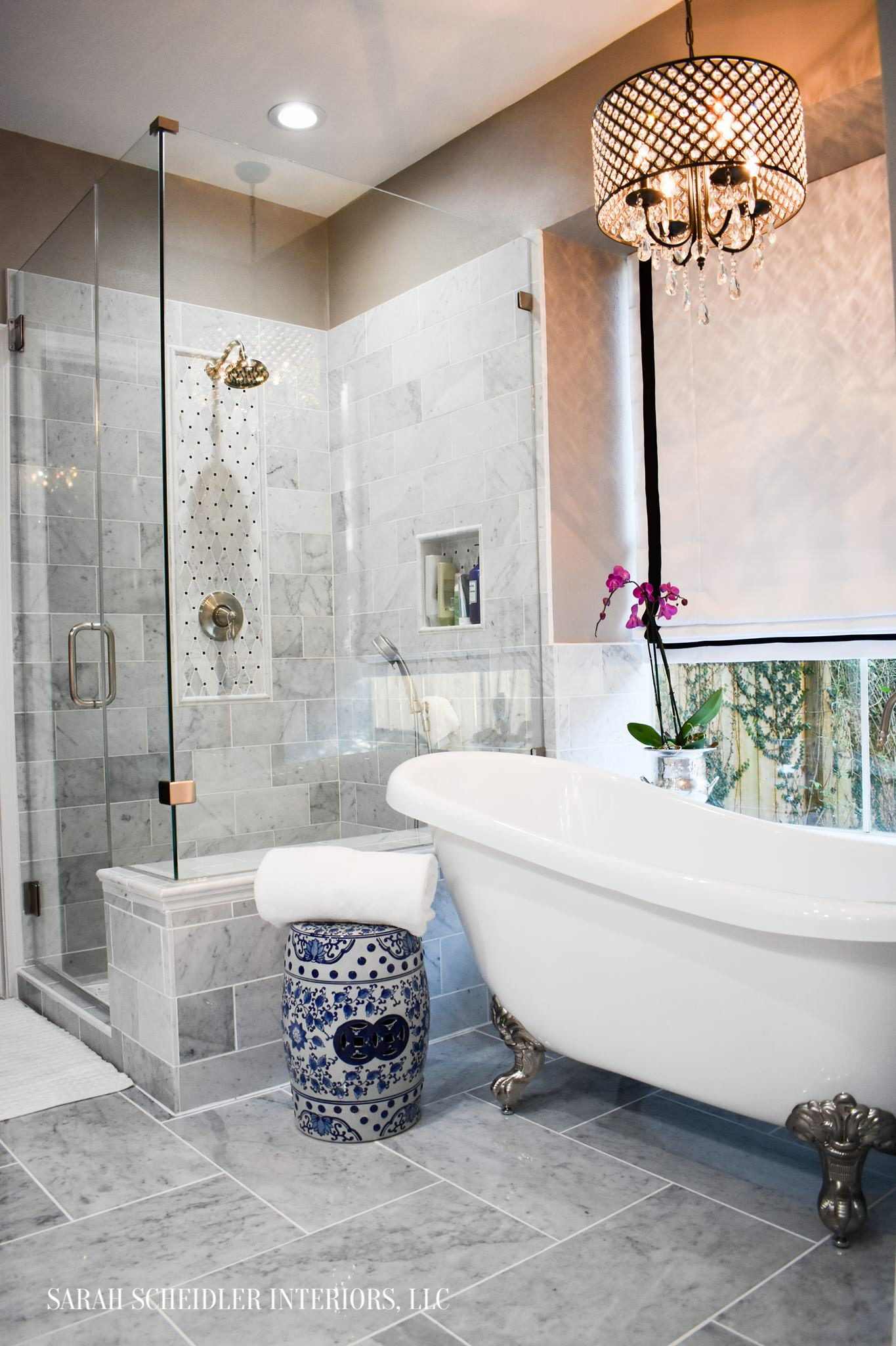 Marble Master Bathroom Design with Frameless Shower, Clawfoot Tub, Crystal Chandelier and Pink Orchid