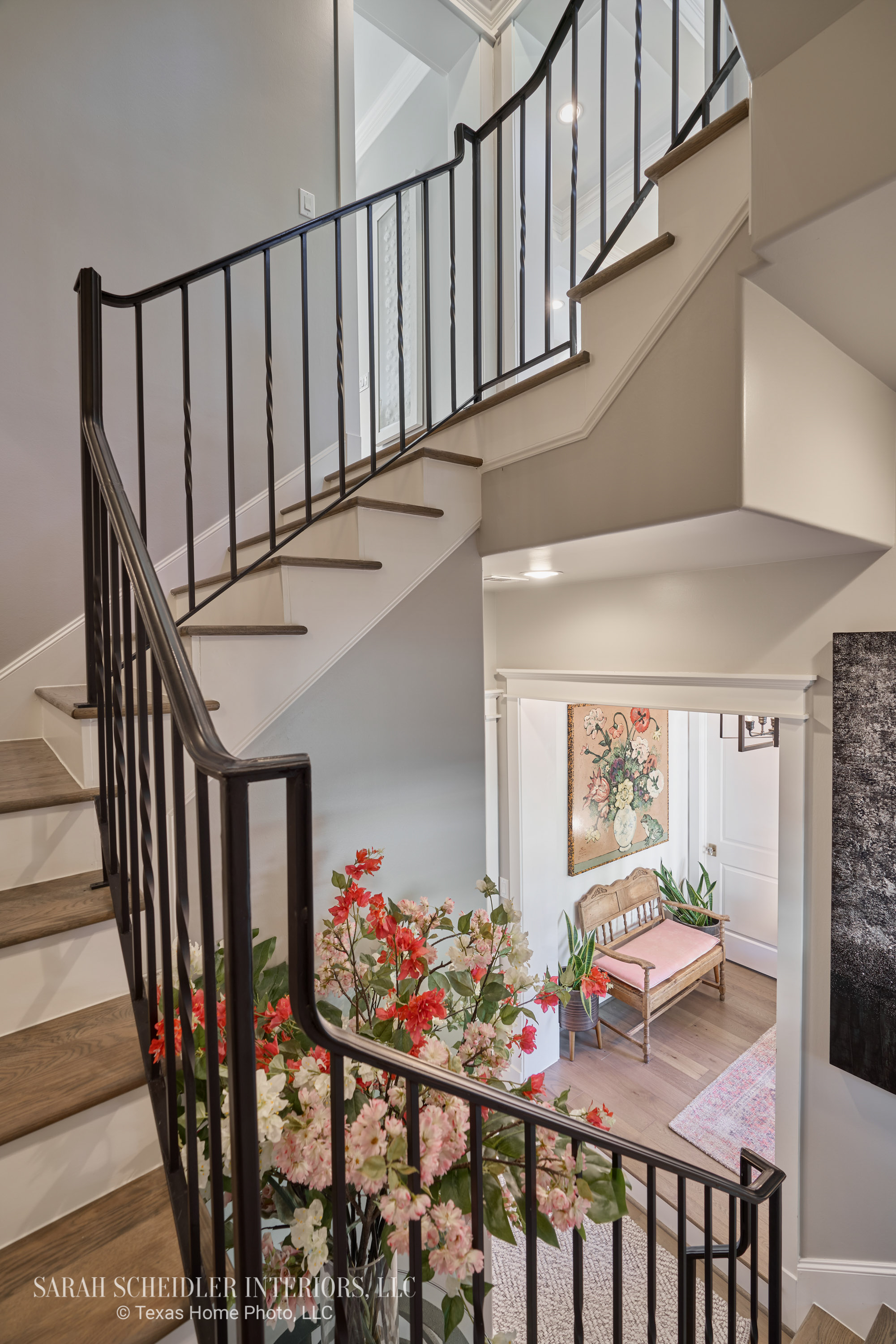 Stairway Design with Large-Scale Art and Greenery and Florals