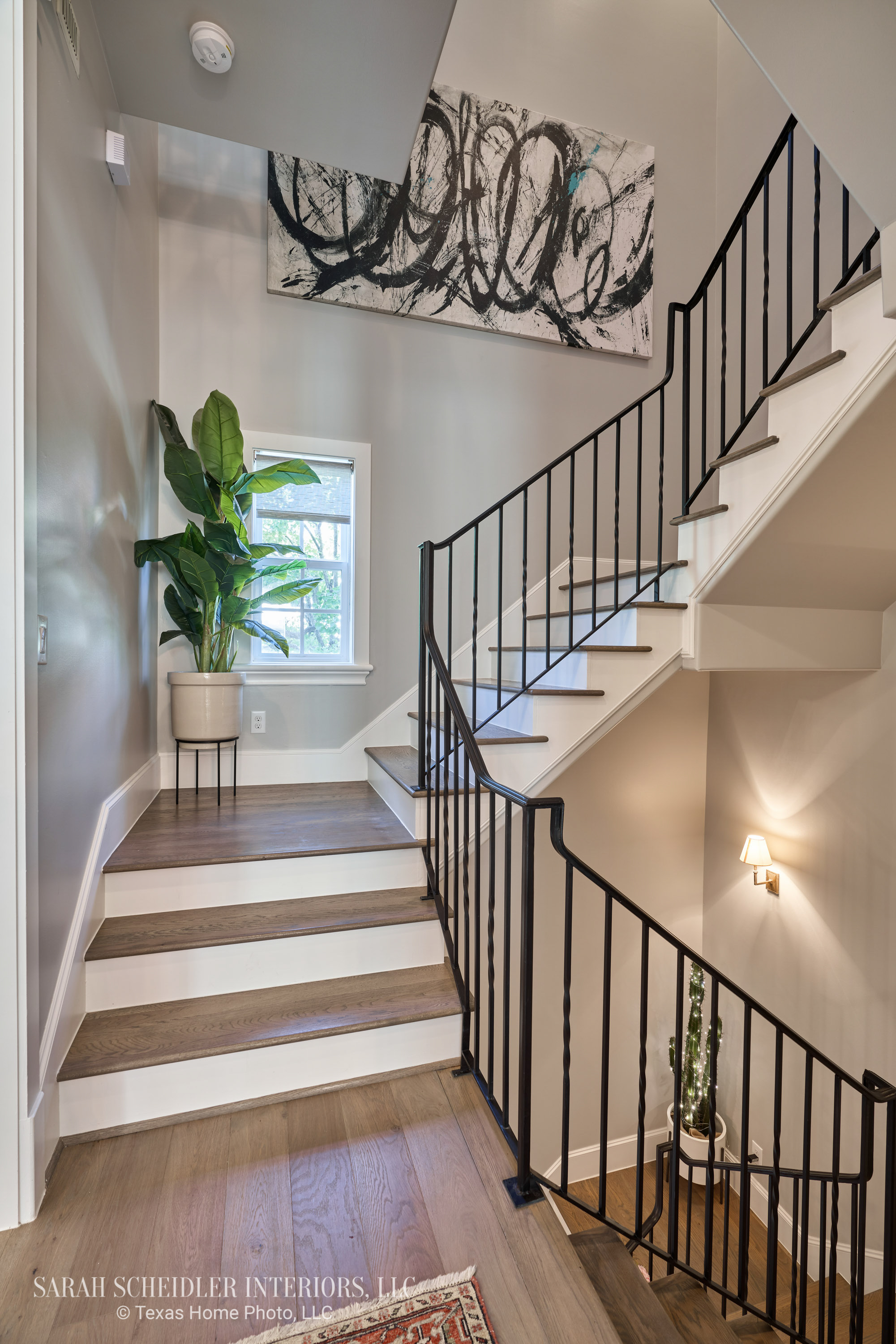 Hallway Design with Large-Scale Art and Greenery