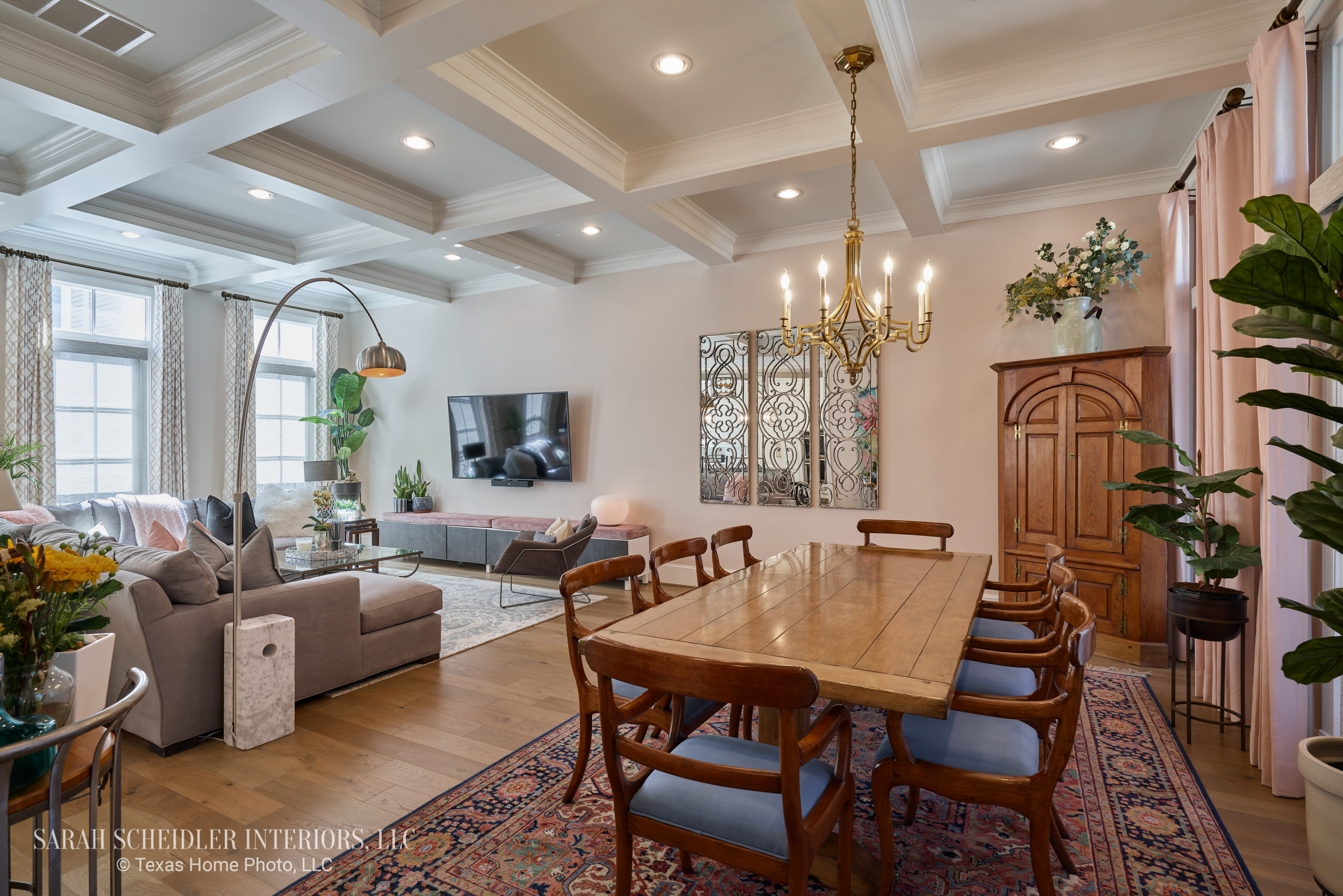 Open-Concept Dining Room and Living Room Design with Pops of Color, Decorative Wall Mirrors, Custom Drapes, and Antique Dining Set