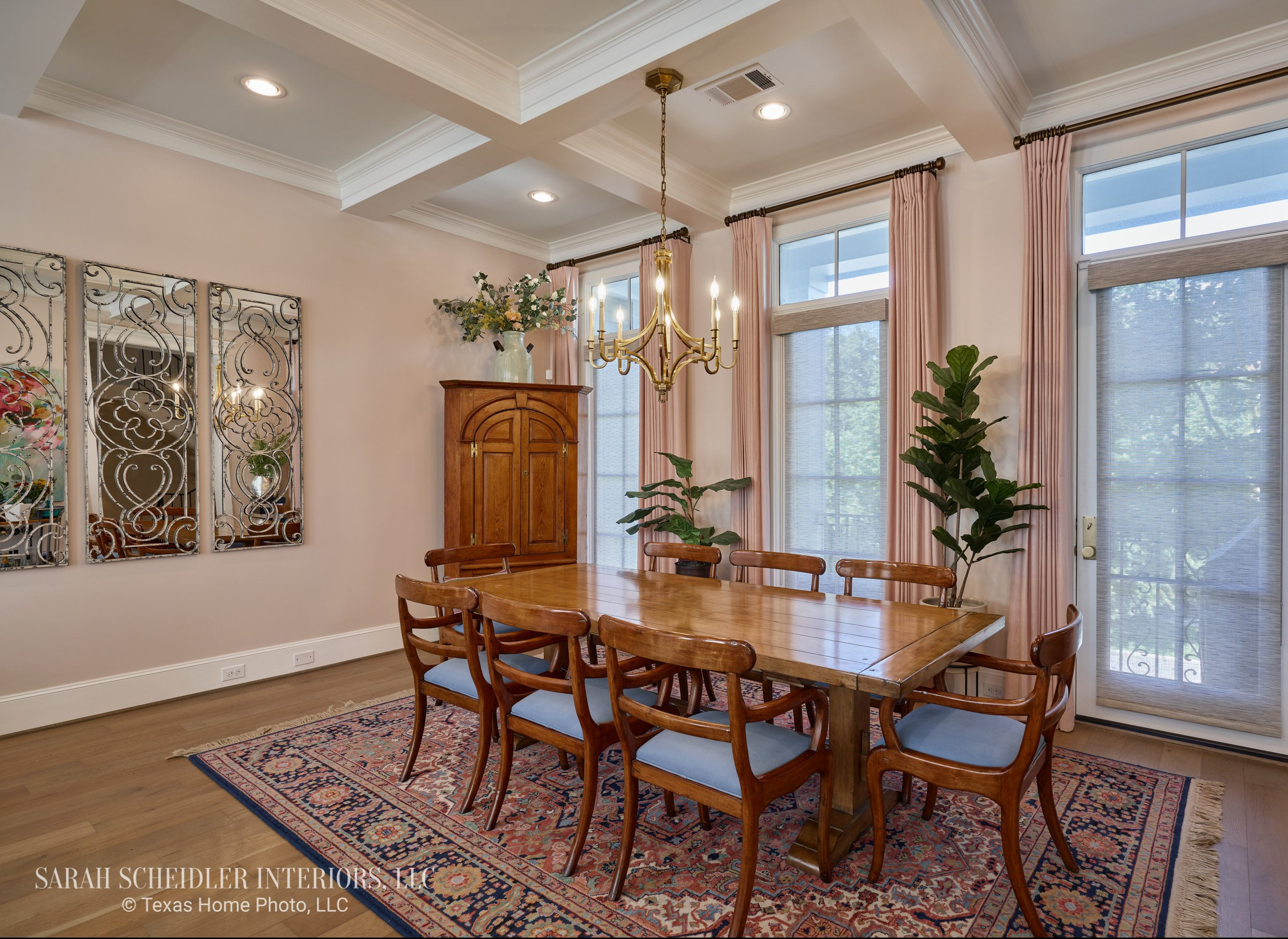 Open-Concept Dining Room Design with Brass Chandelier, Decorative Wall Mirrors, Colorful Area Rug, Antique Dining Set, and Custom Arlon Luxe Linen 71 Petal Drapes