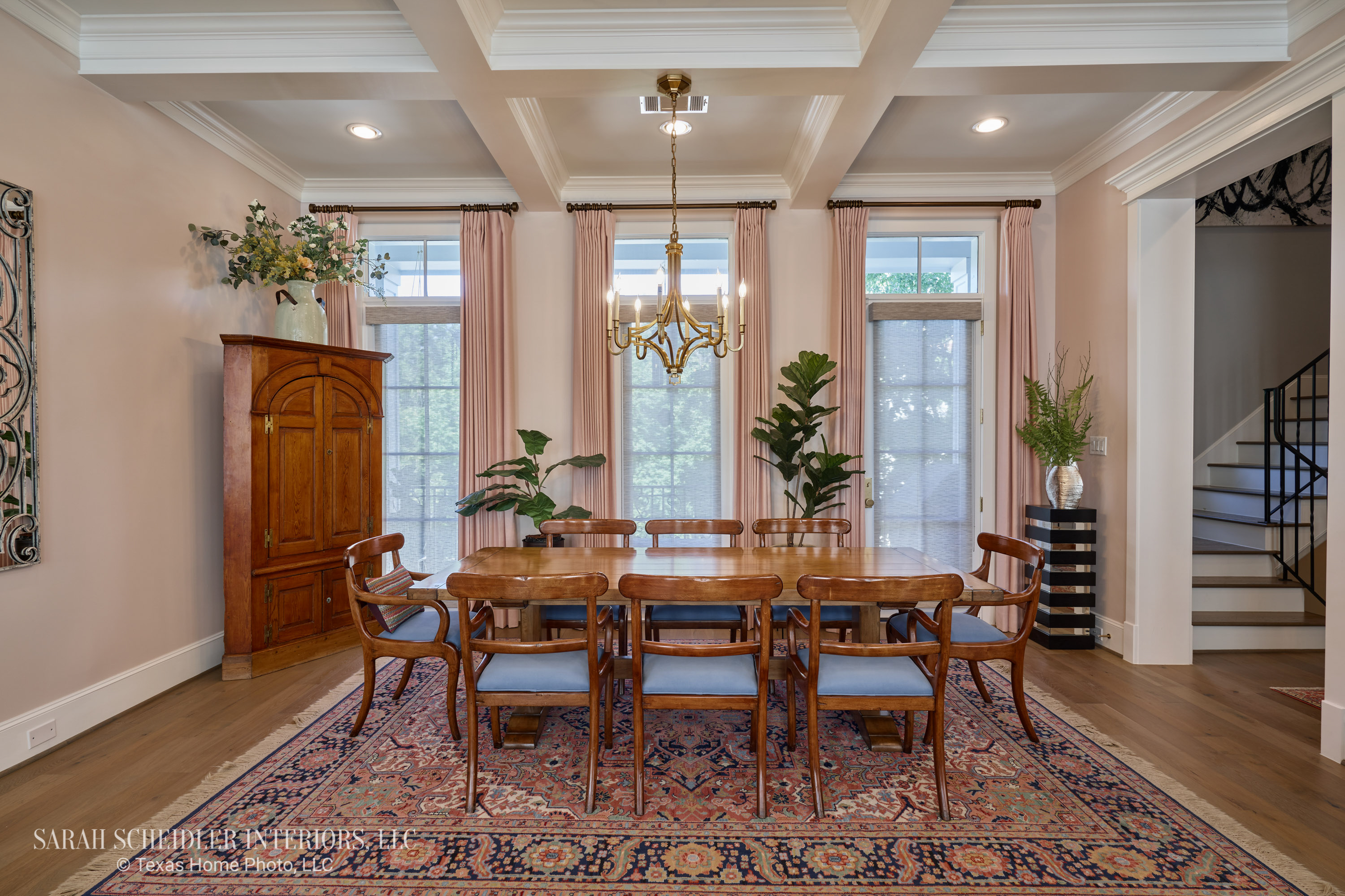 Open-Concept Dining Room Design with Brass Chandelier, Colorful Area Rug, Antique Dining Set, and Custom Arlon Luxe Linen 71 Petal Drapes