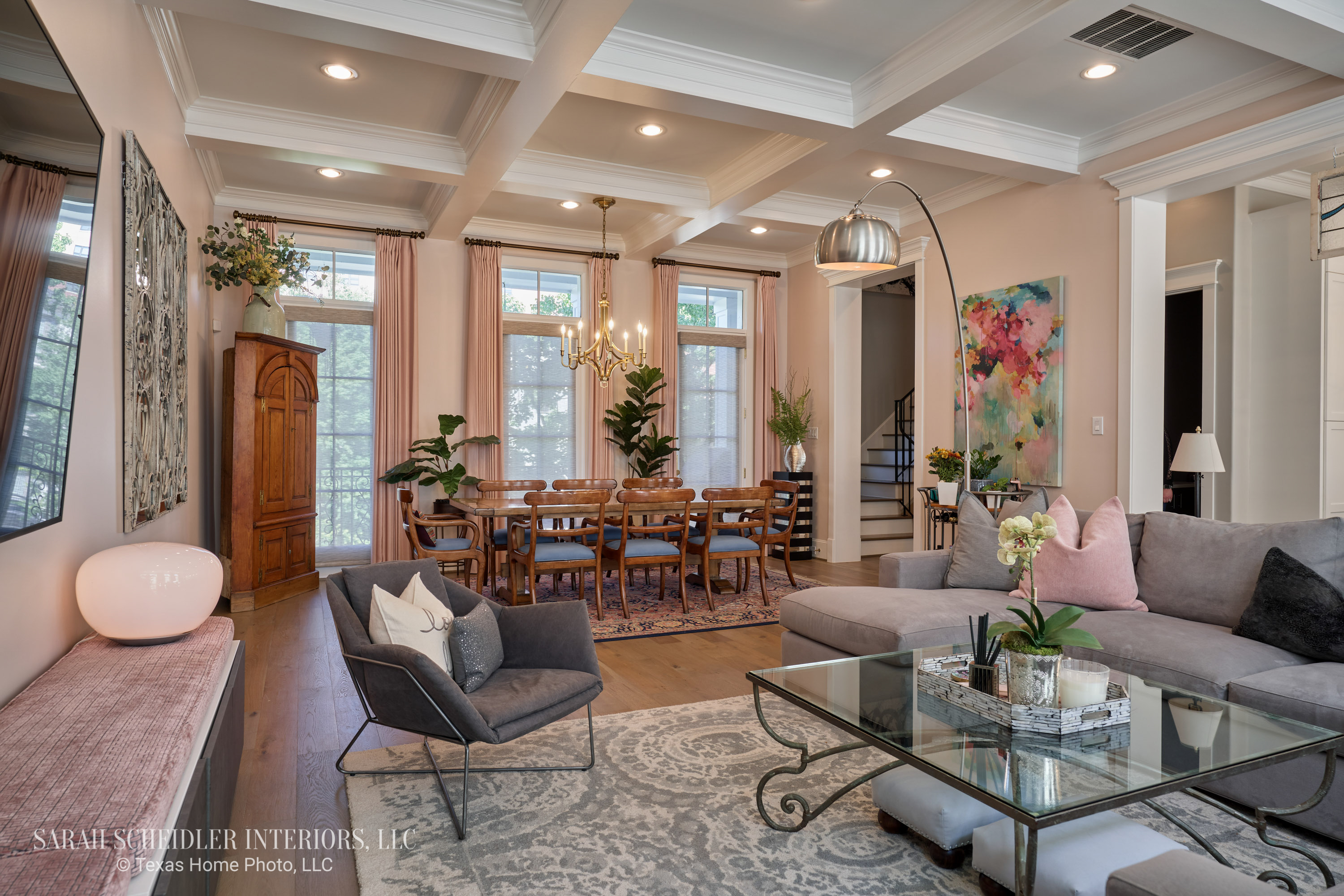Open-Concept Living Room and Dining Room Design with Pops of Color, Decorative Wall Mirrors, Custom Drapes, and Antique Dining Set