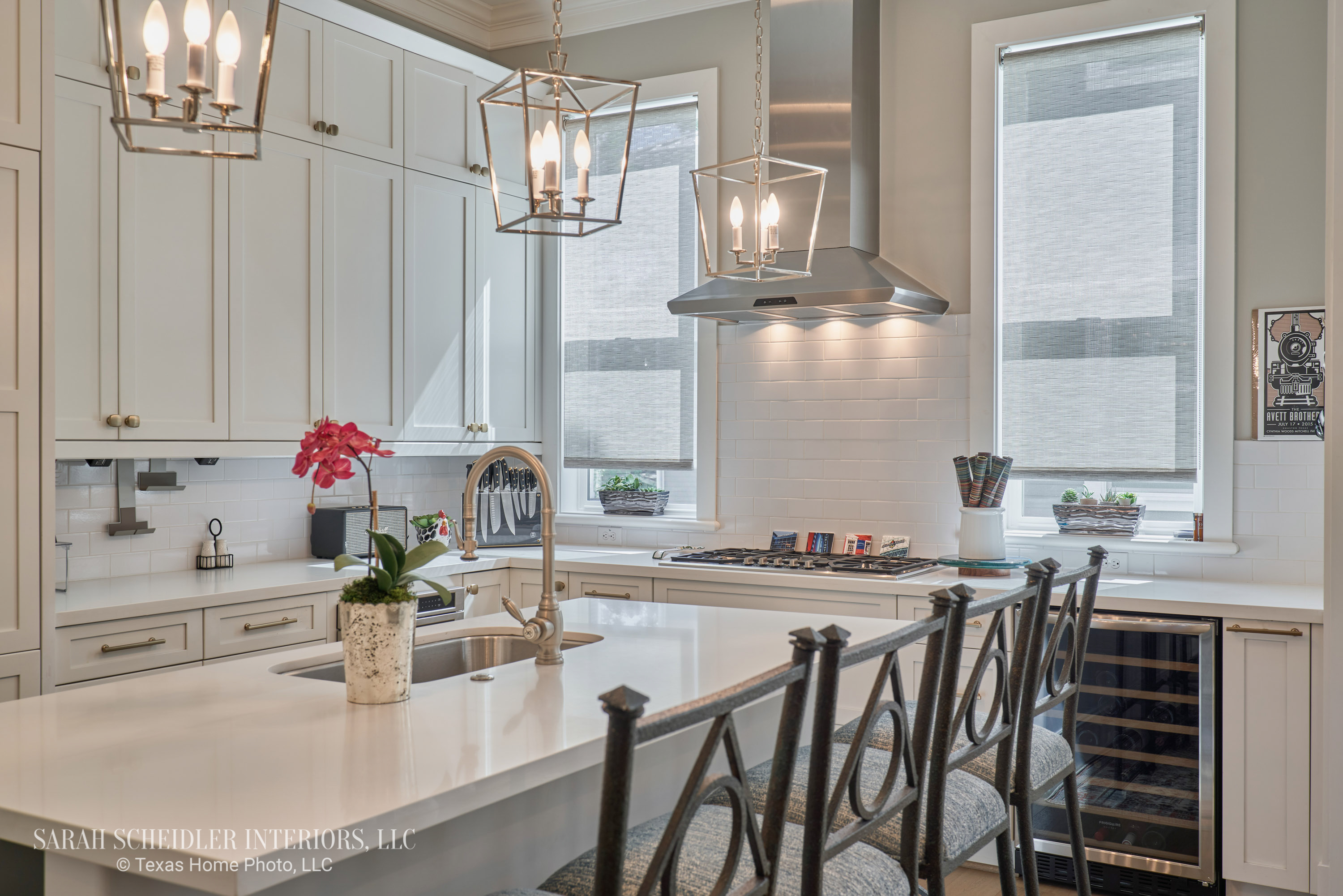 Stunning White Kitchen with Lantern Pendants, Reupholstered Bar Stools, Faux Fuchsia Orchid, and Sheer Custom Window Shades