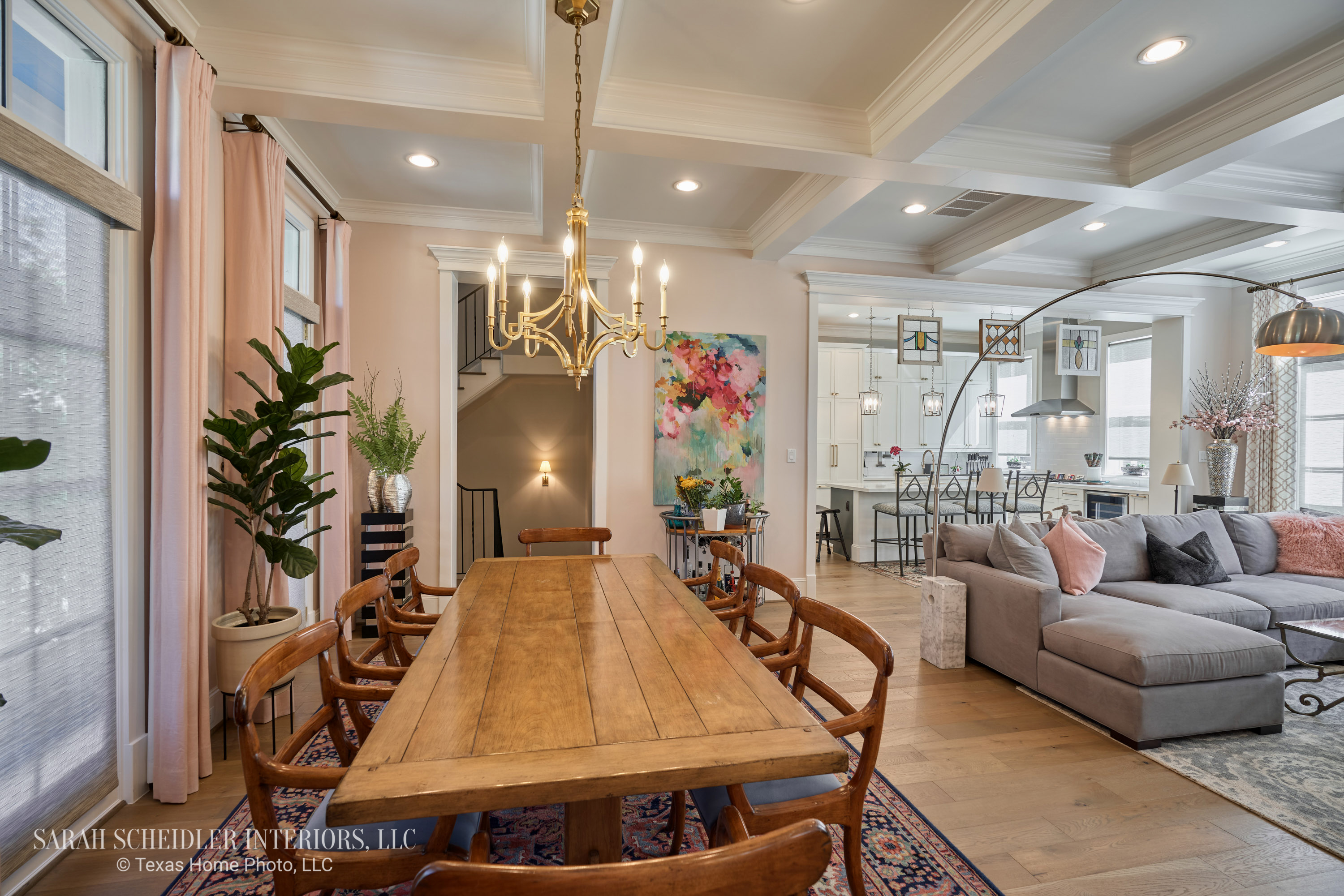 Open-Concept Dining Room, Living Room, and Kitchen Design with Colorful Art, Rugs, Accents, and Custom Drapes